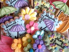 Flowers and umbrella cookies with glitter - gorgeous! I love the beading on the edge of the umbrella!