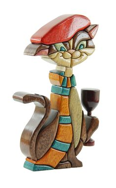 French Cat (CAT10) Amazing unique wood art by artists John and Martha Barrow. Each wooden sculpture is made of Amazonian Ishpingo wood (Scientific name: Amburana Ceará) that is crafted by hand and is colored using natural dyes. Learn more at: http://www.zollera.com