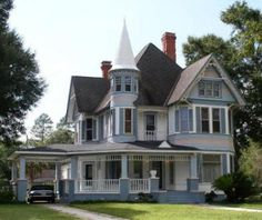 Google Image Result for http://www.littlekidstuff.com/images/queene-anne-dollhouse-real-house.JPG