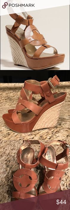 Guess Dailona Wedge Sandals • Strappy platform wedge sandals. Ring detail at vamp. • Brown Leather: Espadrille-style wedge. Leather platform. • Ankle strap with prong buckle closure Guess Shoes Wedges