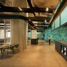 Gold and Turquoise Restaurant Decor in Barcelona mirrored sealing reflects turquoise