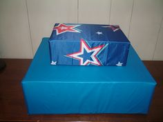 DIY July 4th cupcake stand for $2.  Cover large box on bottom with tablecloth from Dollar Tree & cover little box with flag from Dollar Tree.