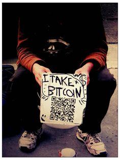 homeless man accepting bitcoin