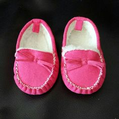 NEW Pink baby moccasins These shoes are just the cutest things. My baby never got to wear them. They're brand new. Not sure what brand they are. Shoes Moccasins