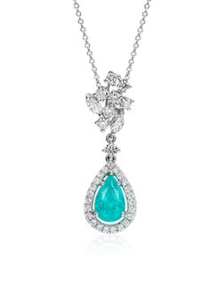 This one-of-a-kind pendant features a vibrant 1.55 ct. Paraiba tourmaline gemstone framed with a halo of round brilliant diamonds in an elegant drop design of platinum.