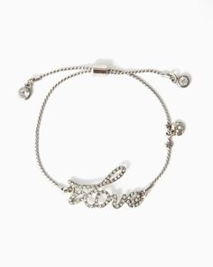 Wear your heart on your wrist with a charm bracelet featuring a cursive pavé rhinestone Love plate with one itty bitty heart and two rhinestone charms on a cable chain.