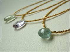 adove fine jewelry delicate gemstone necklace.  briolettes of moss aqua marine, praisiolite, rose de france amethyst drip from 24k gold plate beads, finished in 14k gold fill.  adove fine jewelry.