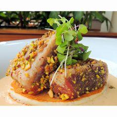 Trump Waikiki - Seared Pistachio Crusted Ahi with Thai Red Curry Sauce, Buttermilk Pancake, and Microgreens.