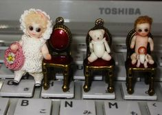 """Miniature bisque dolls with glass eyes, by artisan """"Baby Kobo"""""""