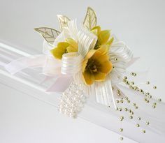 "Corsage on the Precious bracelet with Gold Gleaming Leaves and Gold Pearl Sprayzz with ""Illissa"" ribbon"