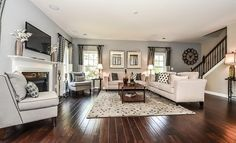Wood floors and a cozy fireplace make this living space from @Lenna Rivera Charlotte one of our favorites!