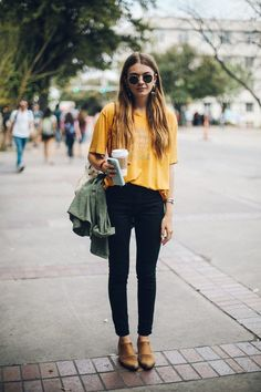Rock an olive anorak with black slim jeans to achieve a chic look. Complement this look with tan leather chelsea boots.   Shop this look on Lookastic: https://lookastic.com/women/looks/anorak-crew-neck-t-shirt-skinny-jeans/18011   — Mustard Print Crew-neck T-shirt  — Olive Anorak  — Black Skinny Jeans  — Beige Leather Crossbody Bag  — Gold Bracelet  — Tan Leather Chelsea Boots