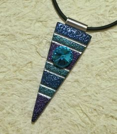 Large polymer clay dagger pendant with large Swarovski Rivoli crystal