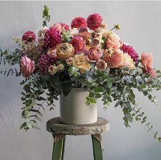 Fuchsia, coral, gold, and green centerpiece Funeral Flower Arrangements, Vase Arrangements, Beautiful Flower Arrangements, Funeral Flowers, Floral Centerpieces, Silk Flowers, Vases, Beautiful Flowers, Fresh Flower Arrangement