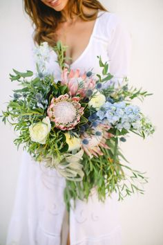 Protea, thistle and greenery wedding bouquet