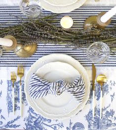 From the classic blue toile linens to the dried lavender garland which lightly perfumes the air, this table is as elegant as it gets. We especially adore the delicate fleur-de-lis detail on the dinner and salad plates. #bridalshowerdecor #babyshowerdecor #eastertabledecor Bridal Shower Table Decorations, Easter Table Decorations, Dinner Party Table, White Wine Glasses, Elegant Table, Provence, Tablescapes, Salad Plates, Linens