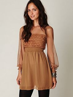 Babydoll dress, paired with leggings. Love the color, perfect for fall and the romantic ruffles.