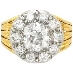 Antique Diamond Silver Gold Cluster Engagement Ring | From a unique collection of vintage engagement rings at https://www.1stdibs.com/jewelry/rings/engagement-rings/