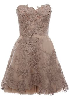 Elegant nude dress with intricate details.