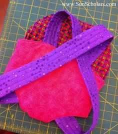 Sun Scholars: Baby Doll Carrier Tutorial. No buttons, tying, or velcro!