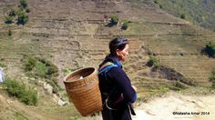 A Black Hmong woman working as a trekking guide