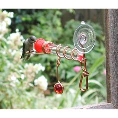 Window Copper Hummingbird Feeder-so much nicer than the plastic version, from| UncommonGoods. For next spring.