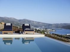 Situated on a gentle hillside, villa Dayo offers enticing atmosphere combining design and luxury with extraordinary views across the bay. Crete Island Greece, Luxury Villas In Greece, Cedar Trees, Pool Maintenance, Stunning View, Beautiful, Swimming Pools, Beach House