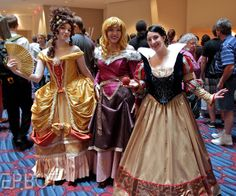 """these ladies are wearing costumes based on artist shoomlah's """"historical Disney princesses"""":"""
