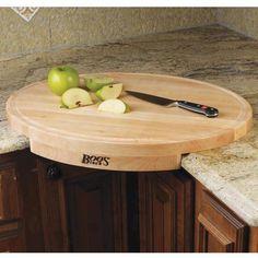 Corner Cutting Board  http://www.lovedesigncreate.com/john-boos-corner-counter-saver-24-by-18-inch-oval-shaped-cutting-board/