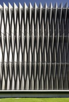 Biomedical Research Center by Vaillo + Irigaray Architects. The building's key architectural feature is the exterior louvers constructed of 3mm-thick perforated aluminum panels arranged in a tessellated origami pattern. The folded facade was designed to screen the glazing along the sides of the building from the sun.
