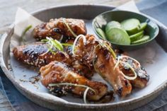"""Savory, chile-spiked gochujang, a delicious condiment from Korea, makes these sweet-and-spicy wings irresistibly tasty and easy to put together. For a cooling accompaniment, serve them with cucumber sticks and slices of mango. If you buy wings that are already separated into individual """"wingettes,"""" you'll need about 2 3/4 pounds for this recipe. Watch our video on gochujang."""