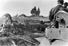 Panzer Tiger assists another  stuck in muddy ground. Russia 1943