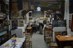 """Μιά ακόμα φωτογραφία απο το καφενείο του Μπέη στη Λάγια της Λακωνικής Μάνης...Με δυό γιούς καλλιτέχνες, έναν γλύπτη κι έναν ζωγράφο, ο χώρος του είναι όλος μιά """"εικαστική παρέμβαση"""", γλυπτά, φωτογραφίες παλιές, τοιχογραφίες, παλιά εργαλεία και με πρωταγωνιστή βέβαια τη θεατρική παρουσία του καφετζή. Γ. Πίττας Coffee Places, Coffee Shop, Greece, Beautiful Places, Street View, Greek Life, Traditional, Memories, Travel"""