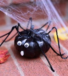 Pumpkin Spider  Turn a mini pumpkin into a scary spider. Paint it black, then glue on chenille stem legs, googly eyes, and a mouth made from white craft foam.