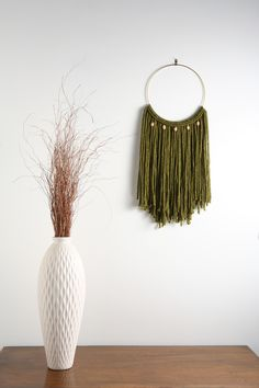 "Emerald Green Macrame Wall Hanging Tapestry on 10"" Brass Hoop w/ Wood Beads.  MATERIALS: - Size: Large - Materials: 100% acrylic blend fibers - 10"" brass ring - wooden beads *(The color of the wooden beads may vary)*  Dimensions: 13""w x 28""h  ____________________  The ""Sultry Boho Chic"" Collection exudes everything sexy and girlie! These pieces can be used to accessorize almost any style, but is definitely suited for those lovers of the Bohemian / Boho-Chic and Shabby Chic styles."
