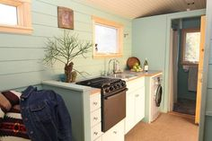 On the other side is the kitchen, which has eight feet of counter space.  #TinyHouseforUs