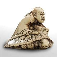 Man on Turtle - Japanese Netsuke : In folklore, Urashima Taro, a fisherman, married the underwater Dragon King's daughter, the princess who could assume the form of a tortoise.