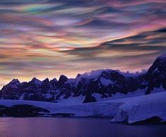 Polar stratospheric clouds (PSCs) form in the stratosphere at altitudes of 50,000–80,000 ft. They are classified into Types I (clouds with more diffuse and less bright colors) and II (nacreous or mother-of-pearl clouds), according to their formation temperature and particle size.