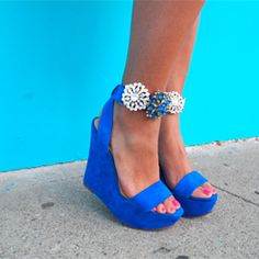 Adding brooches and old earrings is a chic way to DIY up the ankle straps of your favorite wedges.