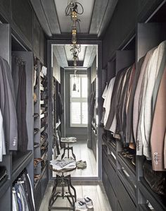 Modern Walk-in Wardrobe with Floor-to-Ceiling Mirror and Grey Shelving