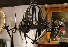 French Vintage 6-light Black Wrought Iron Torchere Chandelier with Fleur De Lis