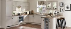Shropshire Kitchen Design Burford Stone- Louise how about a wine fridge in your extra storage space on the pier?!