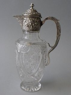 This sterling silver mounted cut glass decanter was made by the silversmithing firm of Edward Streeter, London, in 1902. The cut glass body is cut in a hobnail motif with 4 heart shaped sections, and the silver lid, collar and handle are repousse and chased with floral, scroll and foliate motifs. This decanter would look fabulous at one of the lavish dinner parties hosted by the Earl and Countess of Grantham! For more information, click here.