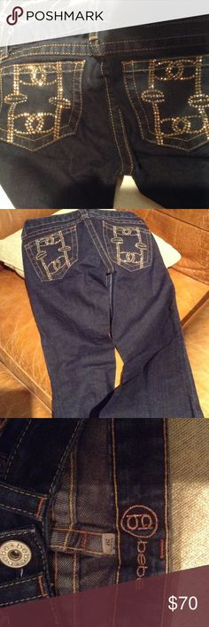 Jeans limited edition Swarovski crystals sz. 25 These were from the fist edition when Bebe decided to go bling....Excellent new condition only wore once for a photo shoot. These limited edition Bebe dark denim blue jeans are embellished with golden topaz Swarovski crystal stones spells out Bebe on back pockets. Size 25 waist. Flare legs at bottom bebe Pants Boot Cut & Flare