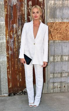 Margot Robbie's 5 Best Fashion Moments of All Time: At Givenchy's spring 2016 show in New York in a white suit | allure.com