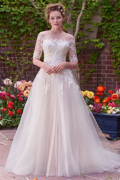 A-line wedding dress idea - romantic gown with lace bodice, sweetheart neckline and layers of tulle - lace jacket with three-quarter sleeves and illusion bateau neckline sold separately - Yvonne from Rebecca Ingram by @maggiesottero