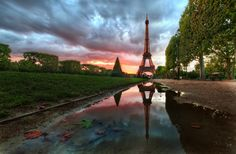 There was a big storm all day long, but I could see the clouds were beginning to break up a little to the west, and I knew there was a possibility the sun would dip into an opening beneath the heavy clouds. So, with that intense possibility, I headed over to the Eiffel Tower area hoping the light would turn out right… - Paris, France - Photo from #treyratcliff Trey Ratcliff at http://www.stuckincustoms.com/