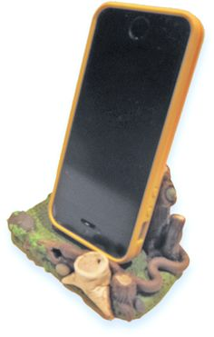 Polymer phone home, A snake crawls through Leslie Blackford's polymer woodland scene and bird peeks out of one of the tree stumps. Moss creeps onto the rocks. The creatures are waiting for something.  This small pastoral scene provides a perfect setting for a cell phone!