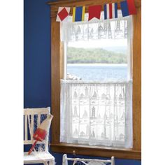 """The <span style=""""font-weight: bold;"""">Lighthouse and Sailboat window treatments </span>are a distinctive lace featuring a marine design of lighthouses, sailboats,sea birds, and marine life scattered throughout the curtain.This curtain has a 1.5 inch rod pocket. Great calm refreshing look. This is the perfect coastal curtain to catch the sho..."""