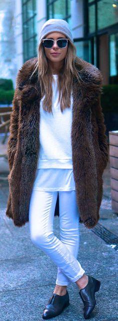 Winter Fur Coat: The Pearl Oyster is wearing a faux fur coat from Zara